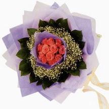 12 adet gül ve elyaflardan   Ordu ucuz çiçek gönder